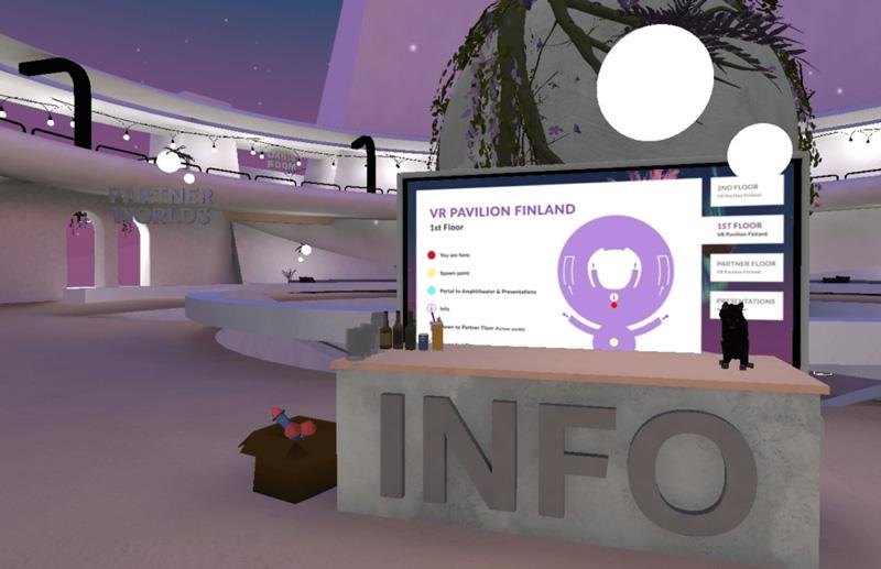 VR Pavilion Finland's info desk. Opens in lightbox.