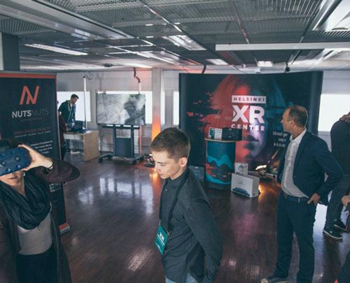 People walking around the Helsinki XR Center showroom.