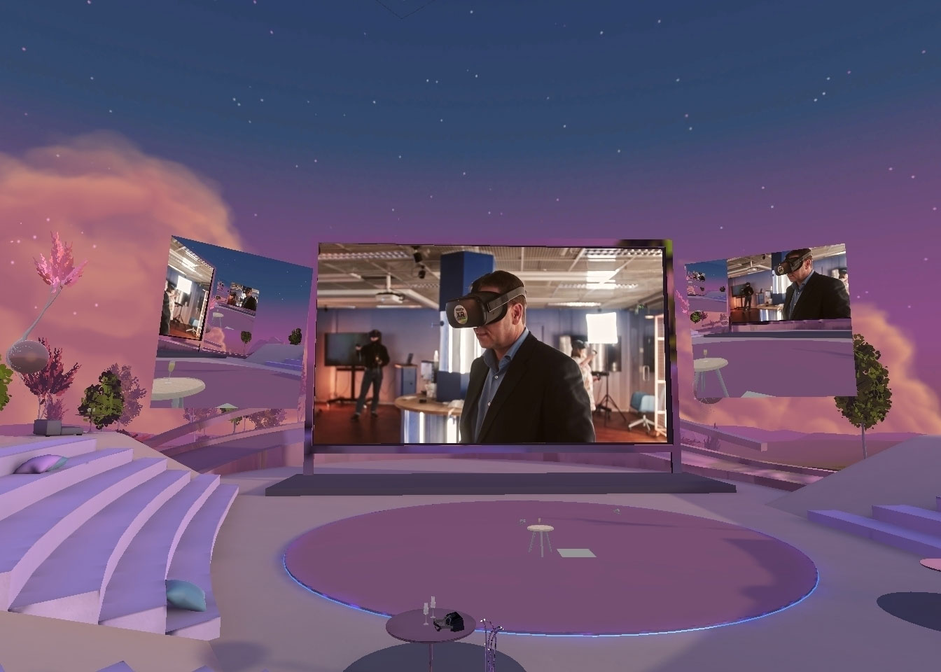 Lilac amphitheater in a virtual reality environment AltspaceVR. There is a big screen in the middle, with a photo of a person vearing a VR headset.