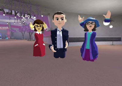 Avatar characters in virtual space Altspace VR. The characters' hands are not attached to their bodies. The avatar on the left is wearing a red dress. The person in the middle is Jan Vapaavuori, Mayor of Helsinki, who's wearing a suit. The person on the right wears a purple-themed dress.