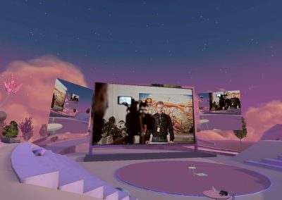 Lilac amphitheater in a virtual reality environment AltspaceVR. There is a big screen in the middle, with a video of a person speaking.