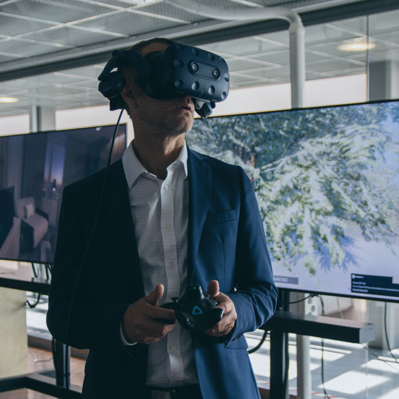 A person with virtual reality (VR) glasses on, testing a VR software at Extended Design Realities event in 2019.