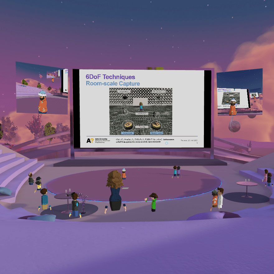 """A screenshot of Match XR 2020 event at the VR Pavilion Finland virtual venue. One big screen and two smaller screens are used for presenting and virtual avatars are watching. The """"evening sun"""" has coloured everything purple."""
