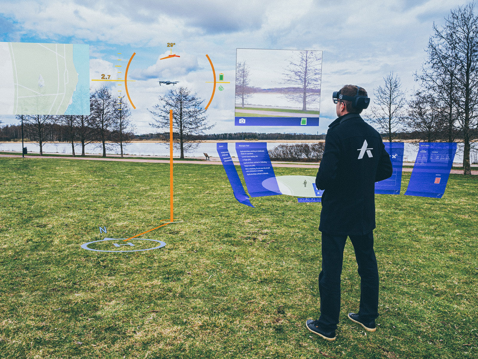 Anarky Labs AirHUD application in use. A person in black clothes is standing on green grass wearing VR goggles. The hud is presented in a visual form around him.