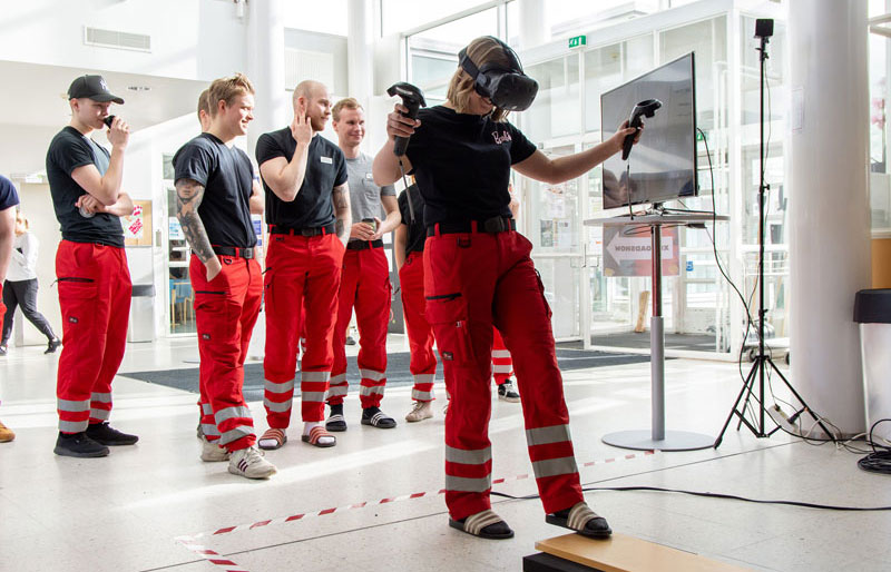 Paramedic students trying out a game on virtual reality headset at one of Helsinki XR Center's XR activities: events in 2019, XR Roadshow.