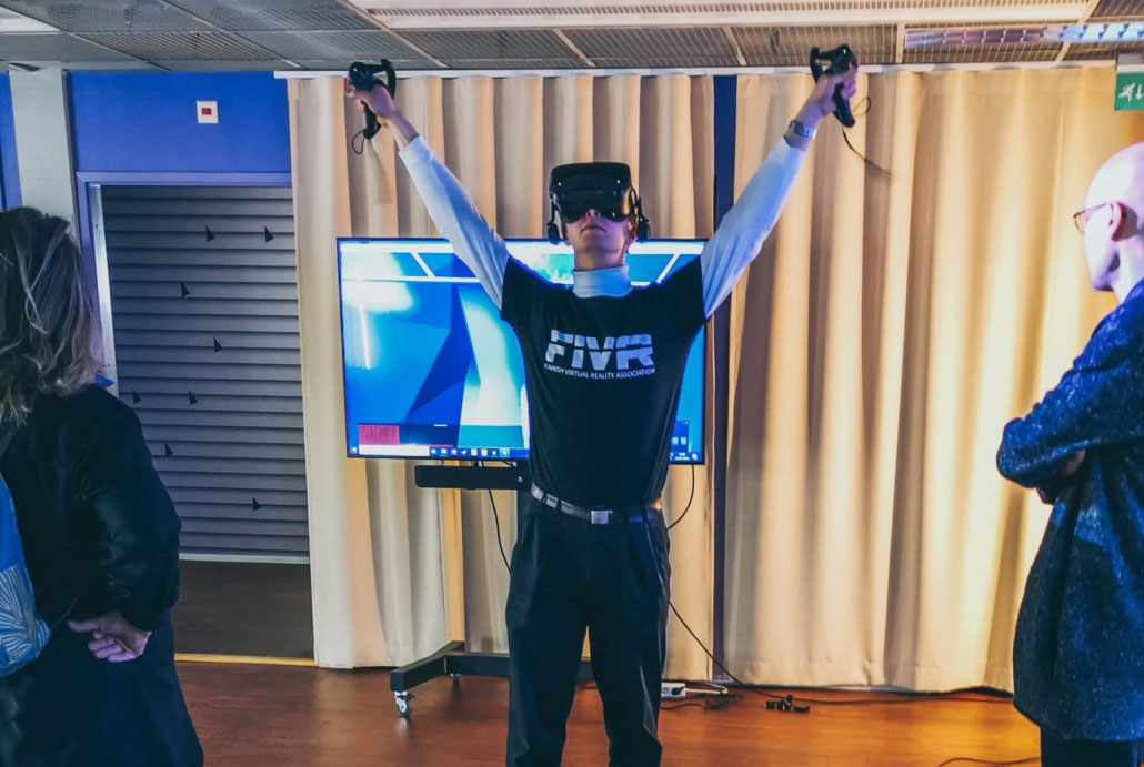 A man with VR headset looking up.