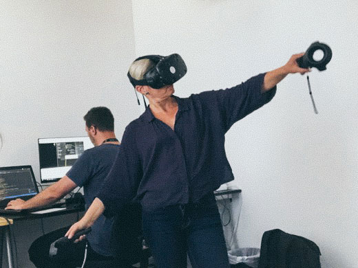 Person in a VR headset doing a powerful motion.