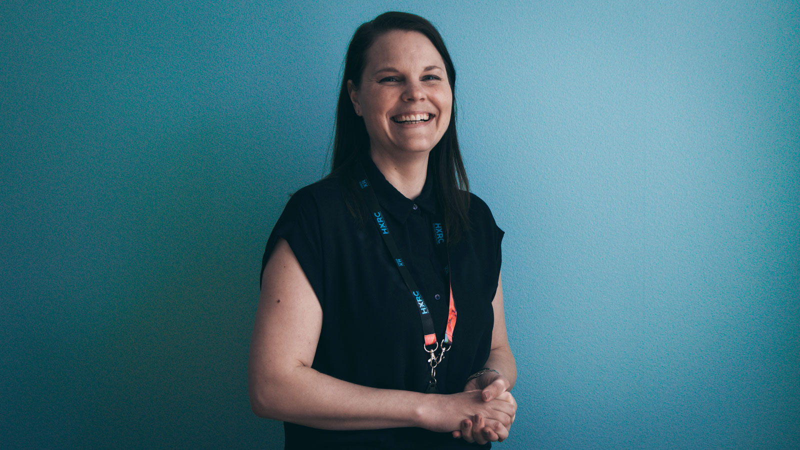 Essi Leivo, Event & Collaboration Specialist at Helsinki XR Center, laughing heartwarmingly.