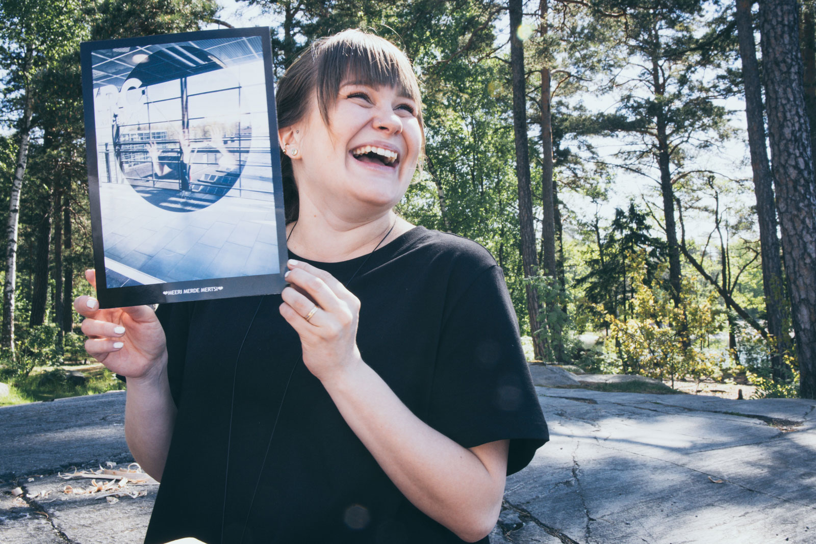 Meeri Lehto smiling with a printed photo of herself.