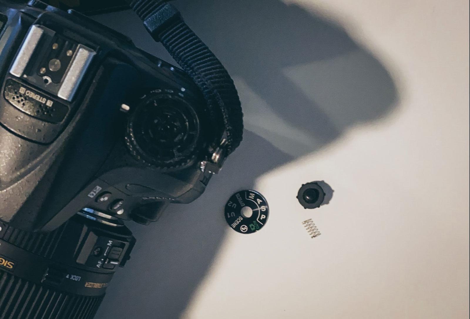 DSL camera with a piece broken off.