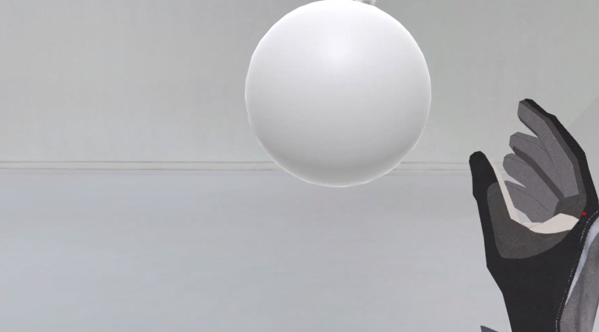 Screenshot from a virtual world: a dark hand reaching for a ball.